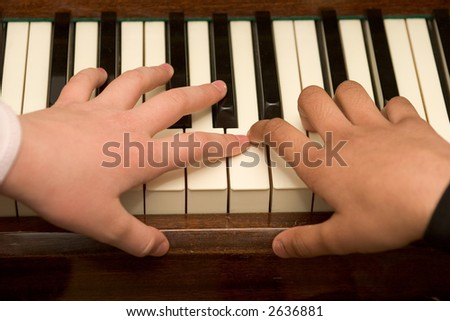 Playing the piano - stock photo