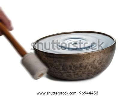 Playing tibetan singing bowl - stock photo