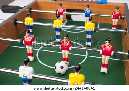 playing toy football players for everyone even in household conditions