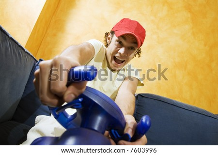 playing video games: guy feet crossed on the bed having fun with his brand new videogame - stock photo