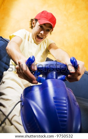 playing video games: guy having fun with his brand new videogame - stock photo