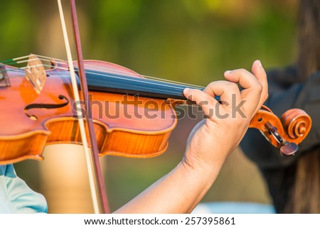 Playing violin music - stock photo