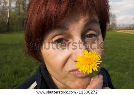 playing with dandelion - stock photo