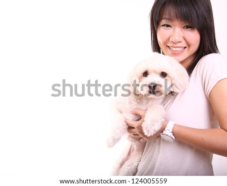 Playing with her dog - stock photo