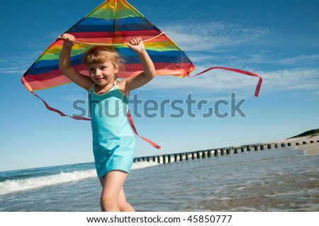 Playing with kite - stock photo