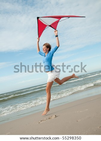 Playing with kite at the beach - stock photo