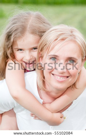 Playing with mother - stock photo