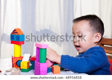 playing with wooden blocks - stock photo