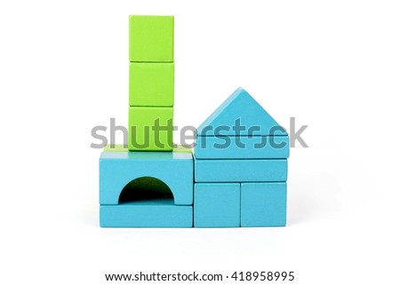 Playing with wooden blocks in the colors blue and green - stock photo
