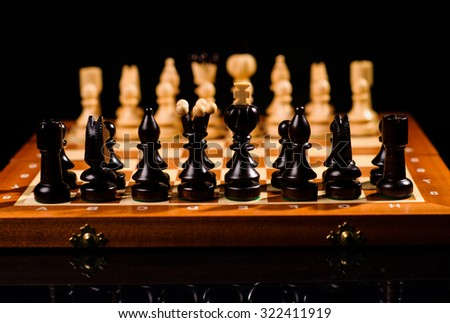 playing wooden chess pieces - stock photo