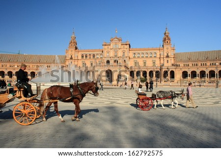 Plaza de Espana with horse carriages - stock photo