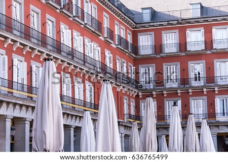 Plaza Mayor in Madrid Spain and Residences with White Curtains and White Umbrellas