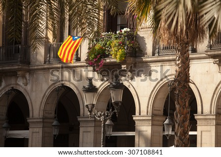 Plaza Reial is a square in the Barri Gotic of Barcelona, Catalonia, Spain. It lies next to La Rambla and constitutes a well known touristic attraction - stock photo
