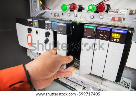 PLC programable logic controler,This picture show hard wiring communication socket connection during technician maintenance