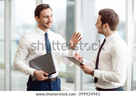 Pleasant business partners talking with each other