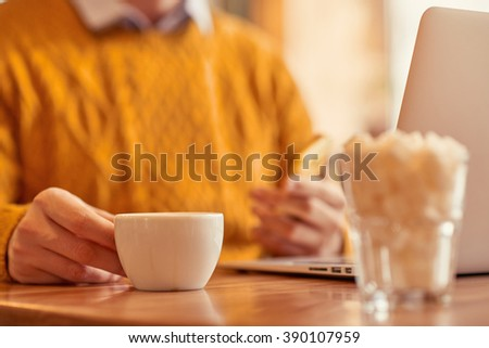 Pleasant man  drinking coffee