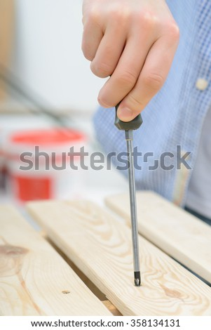 Pleasant man holding screwdriver - stock photo
