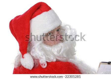 Pleasant middle-aged bearded man in a santa suit isolated on a white background taking notes as to who has been good