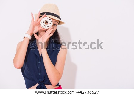 Pleasant positive woman holding donut - stock photo