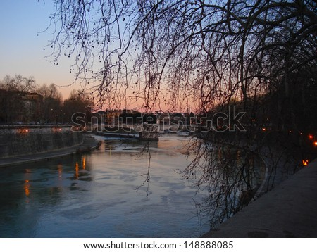 Pleasant promenade on the Tiber bank in the evening.