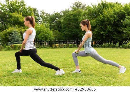 Pleasant slim women doing sport exercises