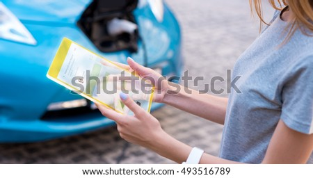 Pleasant young woman using modern device