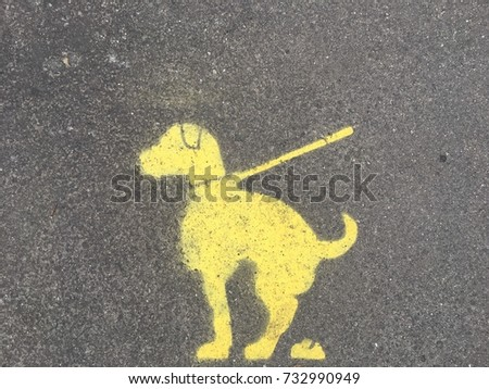 Please clean up after your pet, yellow sign on a pavement