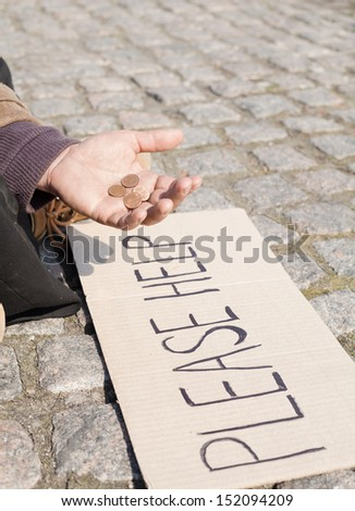 Please help. Close up of tramp asking for some change - stock photo