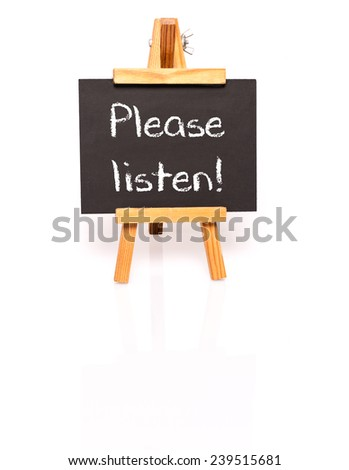 Please listen. Blackboard with text and easel. Photo on white background with shadow and reflection. - stock photo