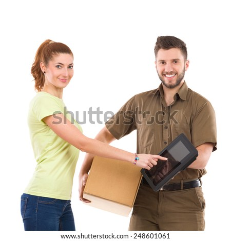 Please sign here. Woman receive a package and pointing at courier's digital tablet. Waist up studio shot isolated on white. - stock photo