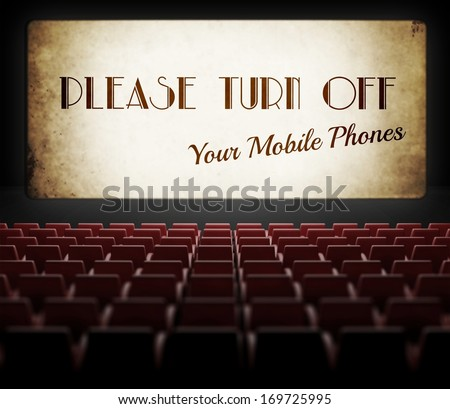 Please turn off cell phones movie screen concept in old retro cinema - stock photo