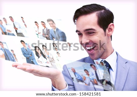 Pleased man admiring pictures on digital screen on white background - stock photo