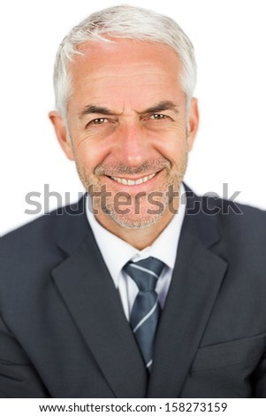 Pleased mature businessman looking at camera on white background - stock photo