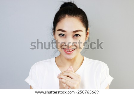 Pleased Thai girl. - stock photo