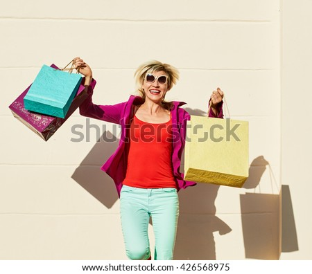 pleased woman shopping bags - stock photo