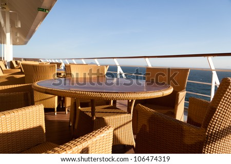 Pleasing and relaxing view from the deck on a cruise ship for summer vacation. This is good to advertise vacation and holidays on cruises. - stock photo