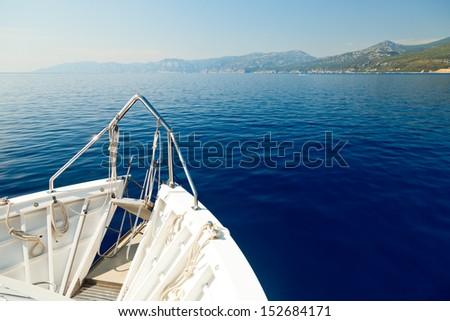 Pleasure boat bow cruising in the sea - stock photo
