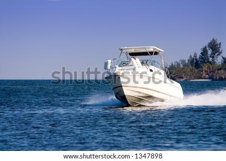 Pleasure boat cruising river - stock photo