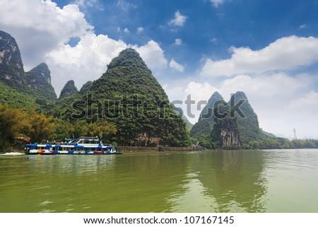 pleasure boat in lijiang river,guilin,China - stock photo