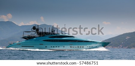 Pleasure boat in movement on mountain background