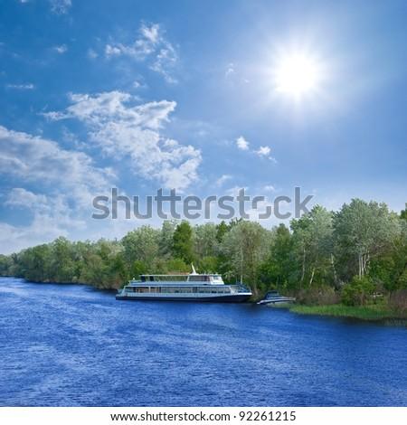 pleasure boat on the river - stock photo