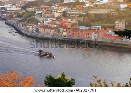Pleasure boat sailing Douro river in Porto, Portugal