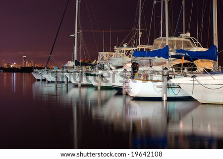 Pleasure Boats Docked at Night in Miami Marina - stock photo
