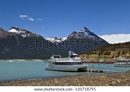 Pleasure boats on the glacial lake at the glacier Perito Moreno, Argentina - stock photo