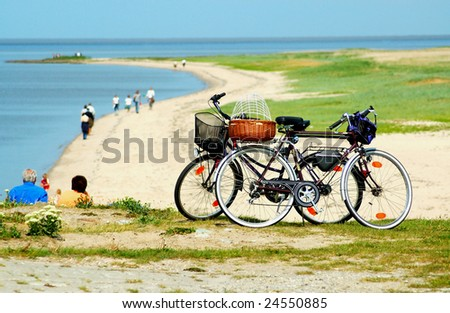 Pleasure trip with bicycles to the coast. - stock photo