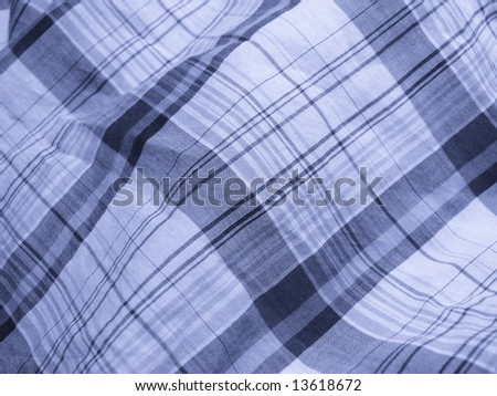 Pleated checkered fabric closeup. Series - blue. Good for background. - stock photo