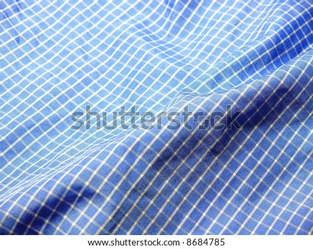 Pleated checkered fabric closeup - series - blue. More fabrics in my port. - stock photo