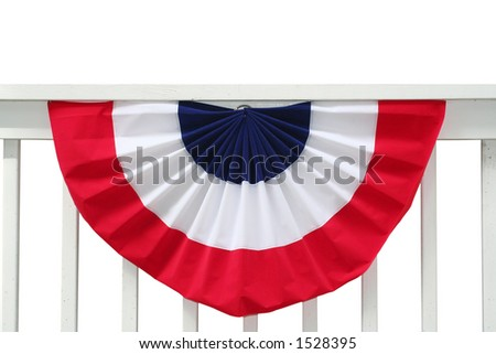 Pleated fan on porch railing - stock photo
