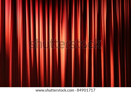 Pleated, red, hanging fabric stage curtain. - stock photo