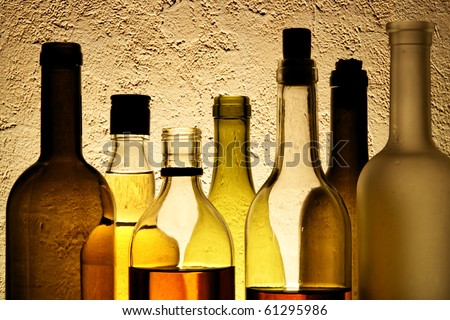 Plenty bottles of alcohol drinks in a row - stock photo